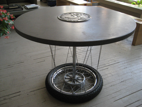 images of 42 inch concrete table with logo