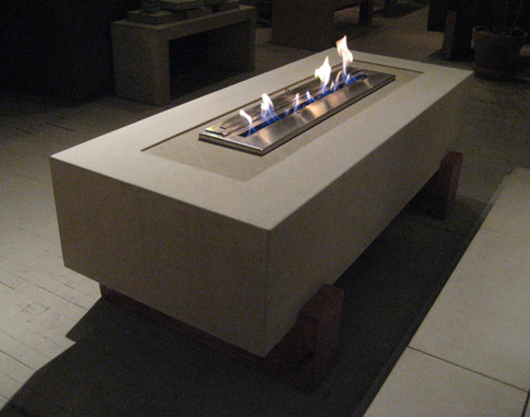images of  concrete free standing fireplace with reclaimed Douglas Fir base